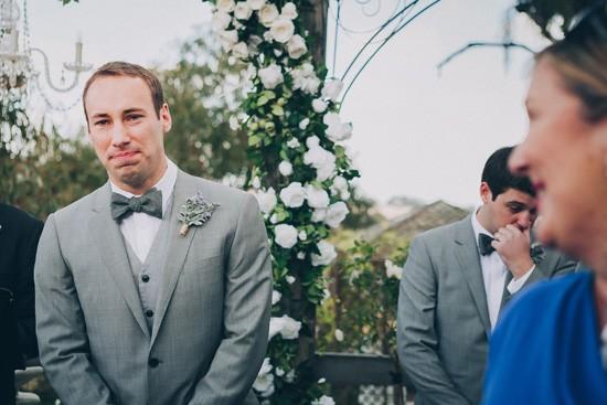 Groom in grey suit with grey bow tie