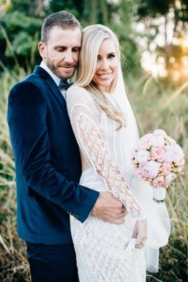 Groom in navy wedding suit