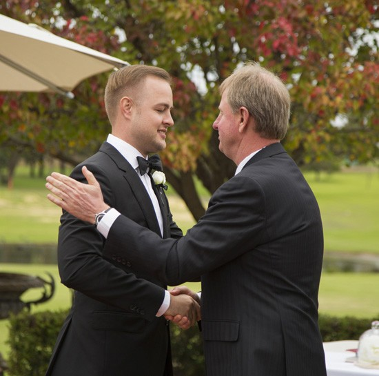 Groom shaking hands