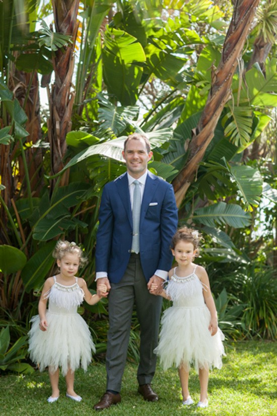 Groom with flowergirls