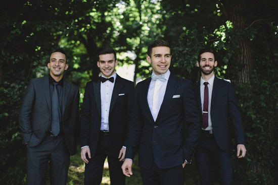Groom with groomsmen in mismatched attire