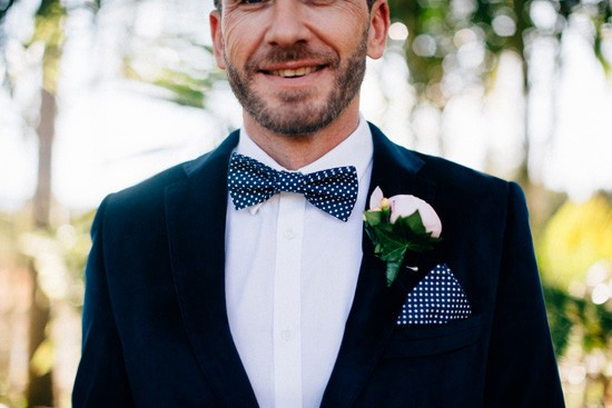 Groom with navy polka dot bow tie