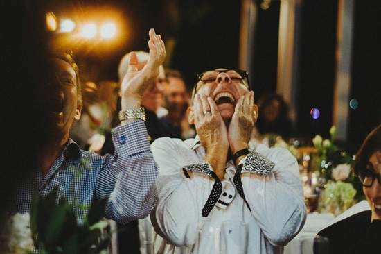 Guest reacting to funny wedding speech