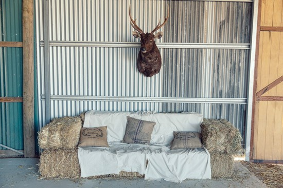 Haybale couch at wedding