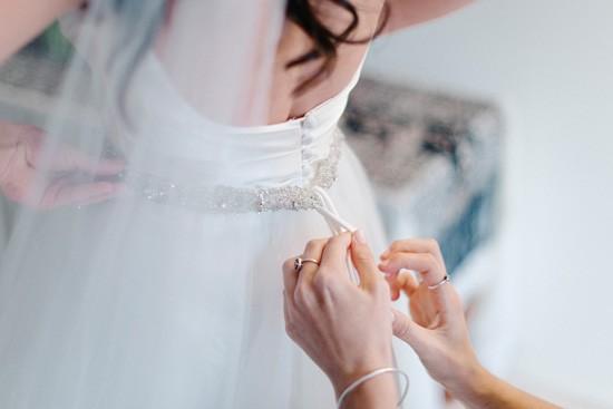 Helping bride get dressed