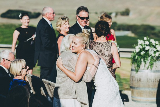 Hugging bride after the ceremony