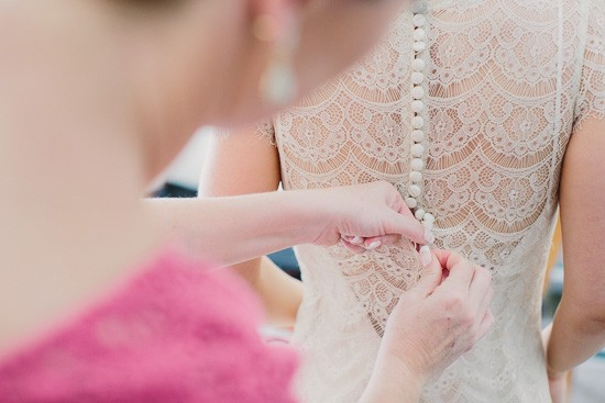 Lace back wedding gown with buttons