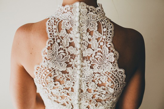 Lace halterneck bridal gown with buttons