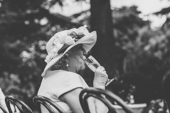 Lady with big hat drinking champagne