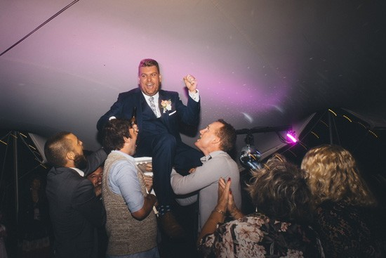 Lifting groom during dancing