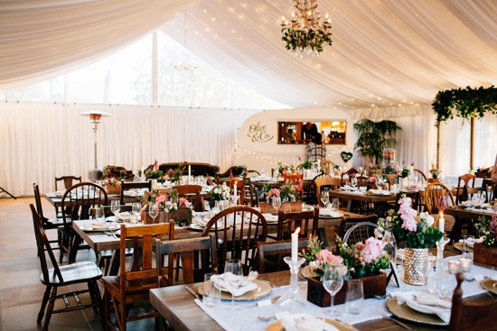 Mismatched wooden chairs at wedding reception