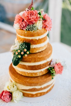 Naked wedding cake with coral flowers