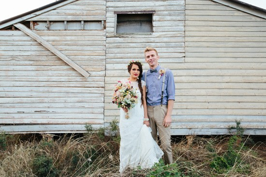 Newlyweds in front of country hall