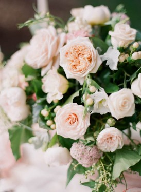 Peach and pink rose wedding centrepiece