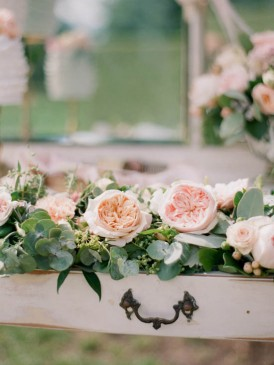 Pink and peach roses with greenery