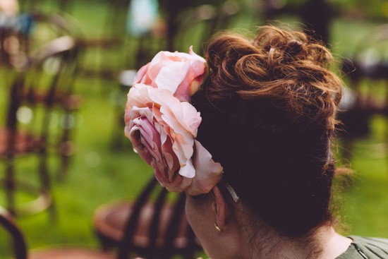 Pink flower in wedding guest hair