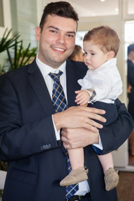 Ringbearer being carried down aisle