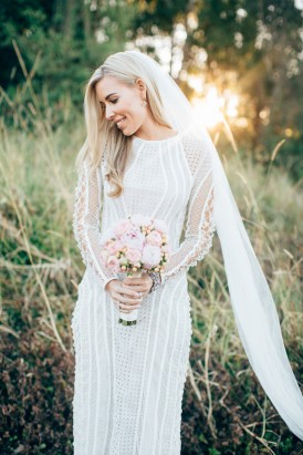 Textured long sleeve wedding gown