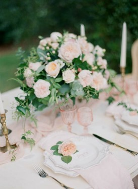 Wedding table setting with pink and peach
