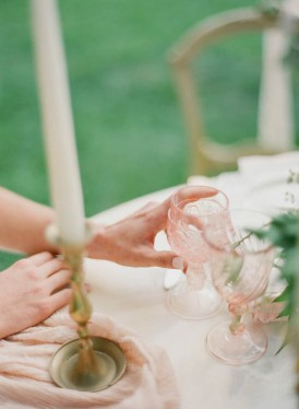 Wedding with brass candlestick and peach glass