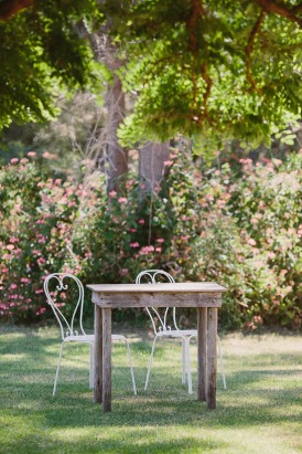 White wire chairs with wooden table for signing