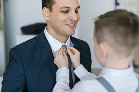 ring bearer doing uo grooms tie