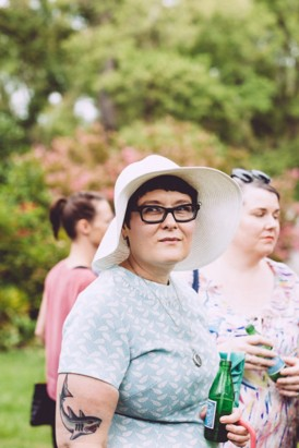 wedding guest with sun hat