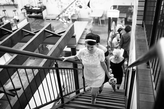 Bride and bridesmaid walking up stairs