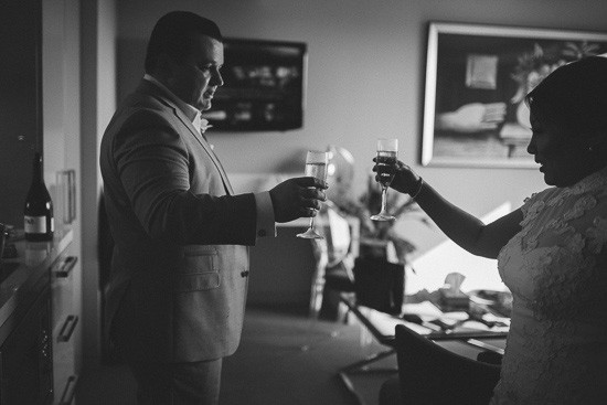 Bride and groom toasting on wedding day