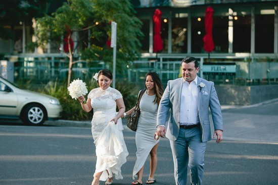 Bride and groom walking to wedding