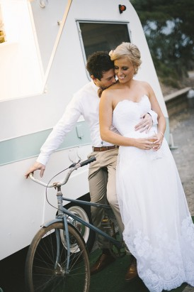 Bride and groom with caravan and bike