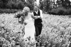 Bride and groom with sun flowers