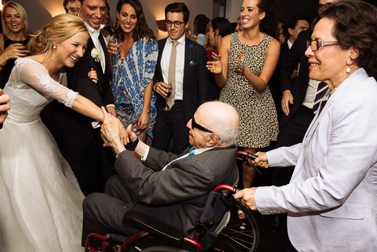 Bride dancing with wheelchair guest