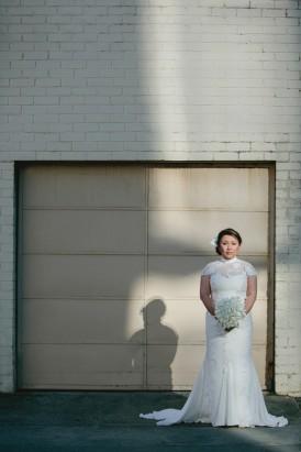 Bride in illusion neck wedding gown