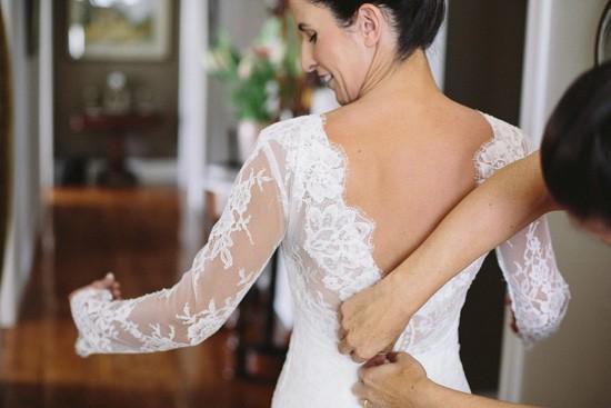Bride in long sleeve wedding gown