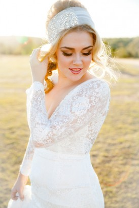 Bride in long sleeve wedding gown