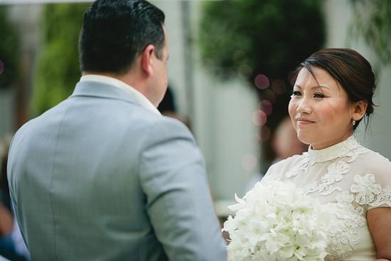 Bride in neck high wedding gown