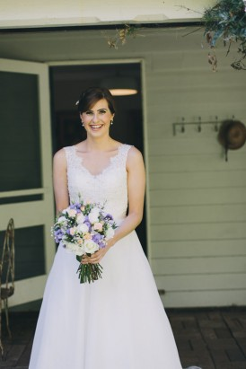 Bride in v neck Maggie Sottero gown