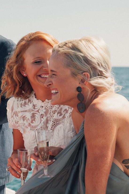 Bride laughign with bridesmaid