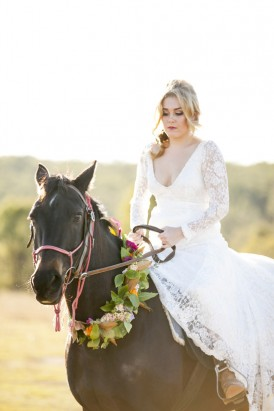 Bride on horse in wedding dress
