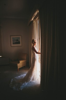 Bride wearing lace wedding gown