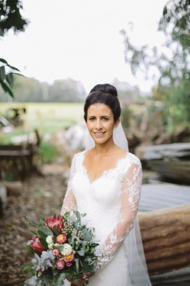 Bride wearing long sleeve wedding dress