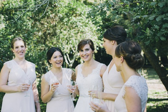 Bride with bridesmaids in nude pink