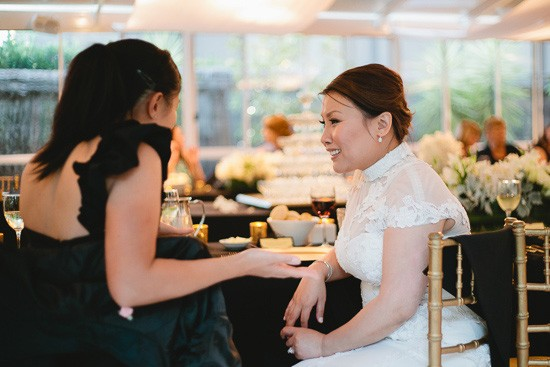 Bride with guest in black dress