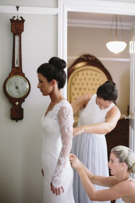 Buttoning up lace long sleeve wedding gown