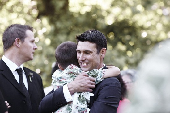 Child hugging groom