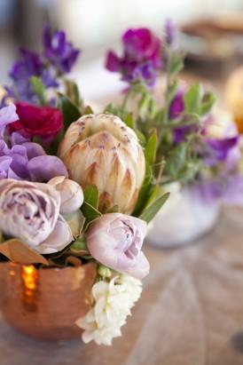Copper and purple wedding decor