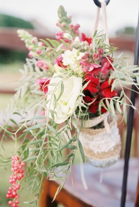 Cream, red and pepper berry floral arrangement