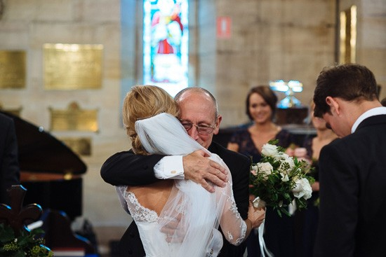 Father and bride hugging before cewremony