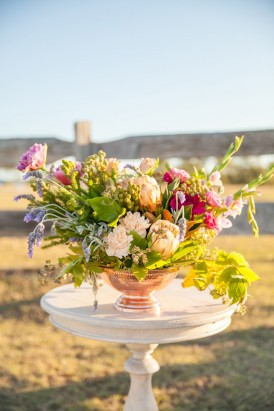 Flower arrangement in copper vase